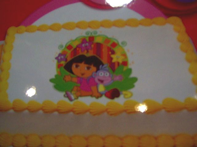 'BC - Dora Theme Cake' from the web at 'http://www.funtastic-events.com/images/Dora-theme-cake.jpg'